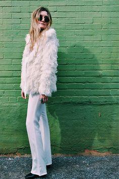 STreet styles: white fur coat and light wash flare denim