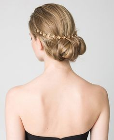 Petal power—If wearing a jewel embellished headband is too much bling try a floral design with pearl-like details that sits at the back of your hairstyle.  Floral pearl-like headpiece, $18.