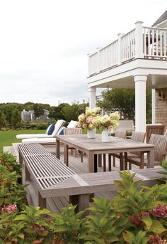 Love the teak wood benches, 2nd floor deck - perfect for outdoor dining, summertime entertaining