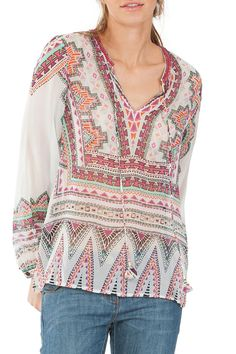 This sheer silk tunic is a vibrant Aztec top with a fun beaded neckline and tie front. The print is just gorgeous and a great pop to any outfit. Great with white or blue denim and wedges or sandals as a great night-out outfit. Beautiful 100% silk is such a dynamic product that we highly recommend. Fits true to size.  Beaded Tunic by Hale Bob. Clothing - Tops - Tunics Idaho