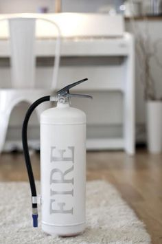 Spotted on Katrines Interior Blog, a DIY project that gives a fire extinguisher a new look. The Kidde Pro 2.5 Water Extinguisher
