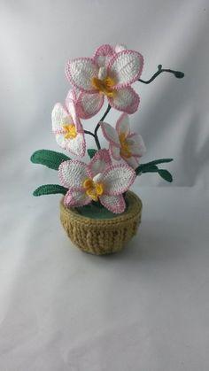 Häkelanleitung Orchideen Topfpflanze https://www.crazypatterns.net/de/items/17019/orchideen-topfplanze