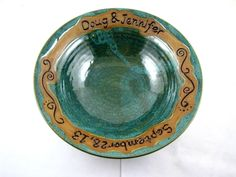 """Personalized Wedding Gift- Names and date wedding bowl. Awesome for Engagement Gift, Bridal shower, Couple's Gift, Housewarming. Wedding gift idea. What a great gift this makes! Whether wedding gift, engagement gift, shower or anniversary gift, this is a very thoughtful handmade pottery gift to give. It also makes a great lovely addition in your home. DESCRIPTION: Measures 9""""-9.5"""" rim wide x 2.5""""- 2.75 tall"""" This listing is for one personalized pottery bowl. The bowl is charming with any..."""