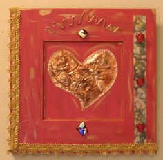 Coquette  Hammed copper heart with gold lace, handmade paper, glass beads, dichroic glass cabochons and copper wire on recycled cabinet door.