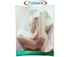 Folded book art Book folding patterns Birthday by WolFabricBooks Book Sculpture, Art Sculptures, Custom Made Gift, Book Folding Patterns, Folded Book Art, Bubble Envelopes, Antique Books, Wedding Anniversary, The Book