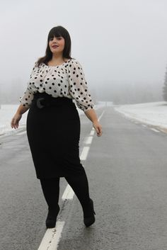 Fun polka dot top, pencil skirt adding visual length with black tight and shoes.