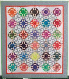 Razzle Dazzle quilt pattern: Bust your stash with this delightful scrap quilt designed by Bonnie Hunter!