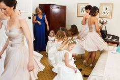 What a fun shot. Rowen Atkinson in Sydney captured this photo of all the bridesmaids and flower girls twirling…except for that one girl.