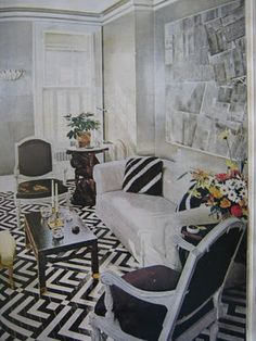 Albert Hadley's stunning and timeless living room with a black and white geometric rug pattern painted on the floor appeared in House Beautiful in 1968 and was featured in the peakofchic blog.