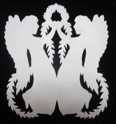Scherenschnitte.  Angels with garland.  One fold design.
