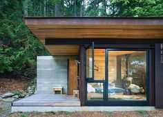 Designed by Olson Kundig Architects  as a bachelor's retreat on Salt Spring Island , this perfect one-room cabin is elemental yet refine...