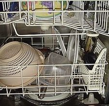 Homemade Dishwasher Cleaner  Mix together 1 cup of borax and 1 cup of washing soda. Fill both sides of the dishwasher receptacle with the borax and washing soda mixture. Place 2 tbsp. of white vinegar into the dishwasher's rinse aid receptacle.  Run the dishwasher using your preferred cycle.