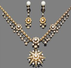 A late 19th century gold, half-pearl and diamond pendant/brooch necklace and a pair of cultured pearl, half-pearl and diamond pendent earrings  The half-pearl and old brilliant-cut diamond floral fringe necklace, suspending a similarly-set star pendant of tiered design, accompanied by an associated pair of cultured pearl, seed pearl and diamond earrings, diamonds approx. 1.50ct. total, one seed pearl deficient, the pendant is detachable and can be worn as a brooch