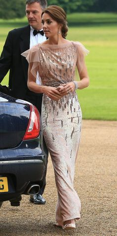 Princess Kate attended a charity gala in a sparkling Jenny Packham gown, which featured fluttery chiffon sleeves and beautiful silver beading throughout. She styled her hair in a chic low bun, and added delicate jewelry, nude pumps, and a sleek clutch to complete her winning look.