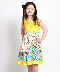 Why can't they make this, but giant?! Bright and bold like a butterfly, this cotton frock is full of color and cheer. Featuring a fusion of playful prints, it's sure to have any little lady looking as darling as a doll.