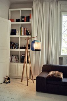 HIVE LAMP, 2010 hive lamp is a floor lamp. the body is made of oak wood and the lamp shade is one of the shades from the bonbon lamps family. photo: ana kraš, vladimir miladinović © ana kraš