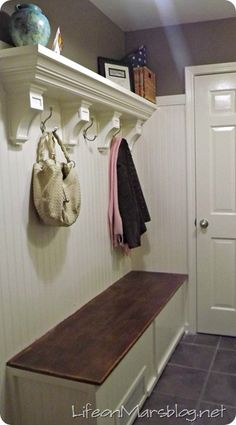 The shelf is made from two pieces of wood, crown molding and 4 corbels.I want to do 2 shelves like this on my big wall going upstairs! and put framed pictures on them. Mudroom Laundry Room, Basement Remodeling, Basement Ideas, Dark Basement, Wall Shelves, Plant Shelves, Home Renovation, Home Organization, Home Projects