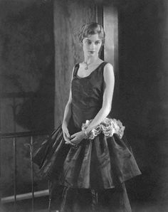1928 Eleanor Sherwin, wearing an evening dress.