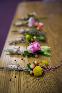 Love the use of different colored wild flowers on these boutonnieres. Perfect for a rustic or shabby chic wedding!   Photo by Leslie Gilbert Photography Pin from DreamWeddingsPA.com