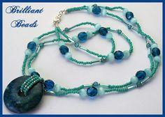 Oceanic...Capri Blue Beaded Necklace with Azurite Stone Donut Pendant-multistrand necklace, stone donut necklace, azurite necklace, Canadian handmade jewellery, artisan necklace, ocean blue necklace