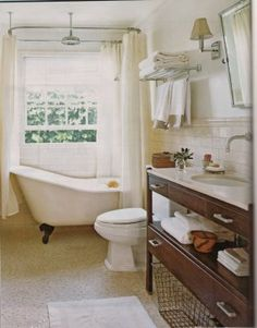 love that vanity, and who doesnt want a claw foot bath tub?