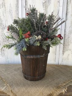 Excited to share this item from my #etsy shop: An Old Sapp Bucket Winter Arrangement, Cardinal and Pine Cones Centerpiece, Christmas Arrangement, FAAP, Holiday Arrangement, Winter Decor