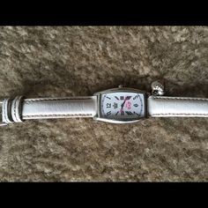 All white, with silver embellishment Watch Small, worn, Juicy Couture watch, signs of wear on band. Very light, still cute for everyday wear. Juicy Couture Jewelry