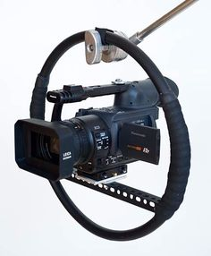 Fig Rig by JLPhoto -- Homemade fig rig constructed from conduit, perforated angle, aluminum plate, bicycle handlebar wrap, and a commercially available camera quick release adaptor. http://www.homemadetools.net/homemade-fig-rig