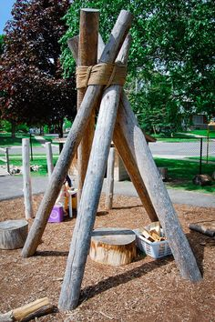 wood teepee, natural playground