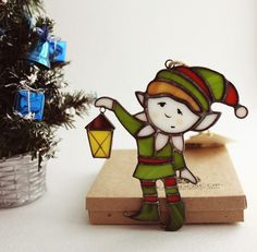 OK MY HAPPY FOLLOWERS....IT HAPPENED  I'M TOTALLY IN WUV WITH THIS LITTLE DUDE! Stained glass elf