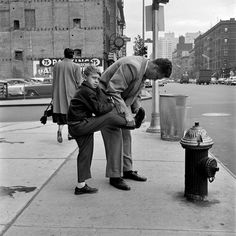 Vivian Maier - This photo looks so clear and real, that I almost feel like I'm intruding!