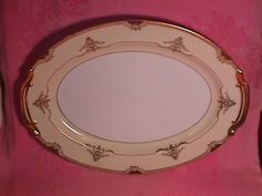 """Noritake China """"Goldier"""" #89494 Turkey Platter. This Turkey Platter is 16 1/4"""" Long by 12 1/8"""" Wide. It is Rim Shape with Gold Trim. This is one of the Most Beautiful Heavy (Gold) patterns by Noritake. The Replacement value of this Turkey Platter is $65.00."""