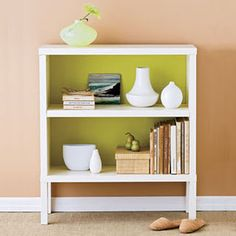 painting the inside of a bookcase or shelving unit to make a collectibles pop