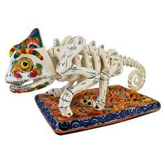 This macabre yet laughable Day of the Dead chameleon has been richly painted in classic Talavera motifs. Each meticulously handmade figure comes from Dolores Hidalgo, Mexico, and embodies all the colorful charm of Mexican Talavera.  (***Really Like This One.) LaFuente.com