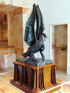 """Phillippe Wolfers , """"The Song of the Swan"""", 1898, is a sculpture in bronze, oak, marble, and mahogany. Wolfers felt this piece to be one of his more important works. He exhibited it in the 1899 Munich Secession and in the 1902 Turin International Exhibition [Esposizione Internazionale d'Arte Decorativa]. The wood base was designed by Belgian architect Paul Hanker."""