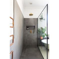 C O N C R E T E S H O W E R OUR CONCRETE, BRICK AND STEEL FRAMED GLASS SHOWER DESIGN.