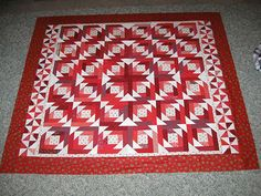 Bonnie Hunters Pineapple quilt in red - called Red Blossoms...love it....