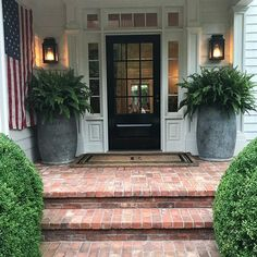 front door, farmhouse front door, exterior of farmhouse, front porch design, front entry design with wreath and front door mat black front door with planters Front Porch Steps, Farmhouse Front Porches, Small Front Porches, Front Porch Design, Farmhouse Windows, Front Entry, Front Door Planters, Big Planters, Fern Planters