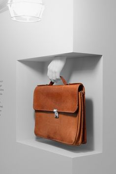 Interesting way to hang your briefcase or purse...