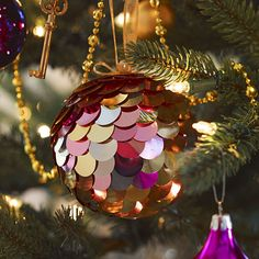 DIY Holiday Decor: Whip up a bunch of these gold, pink and silver ornaments for your family and friends.