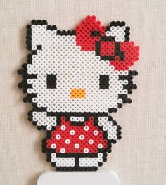 Hello Kitty perler beads by joyeuny and like OMG! get some yourself some pawtastic adorable cat apparel! Easy Perler Bead Patterns, Melty Bead Patterns, Diy Perler Beads, Perler Bead Art, Beading Patterns, Pearl Beads Pattern, Motifs Perler, Hama Beads Design, Iron Beads