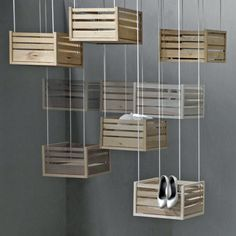 hanging crates.. I like this idea but, I do not know one person who had that much space to take up in a room so, I think it would be cute outside being used to plant herbs or flowers.