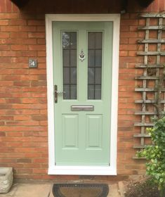 A beautiful Chartwell Green Jacobean with rectangular leaded glass and classic urn knocker. #Rockdoor & A Chartwell Green Cottage Spy View | Decemberu0027s Share u0026 Inspire ...