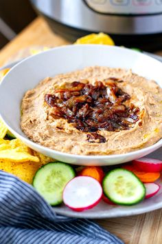 How to make a delicious creamy Instant Pot pinto bean dip with cream cheese, chipotle and caramelized onions. It's gluten-free, healthy and super tasty. Stovetop instructions are also provided #dips #dip #pintobeans #instantpot #pressurecooker #instantpotrecipes #snacks