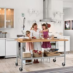 A rolling island is ideal for a compact kitchen. It's the perfect problem solver for storage and counter space. | Coastalliving.com