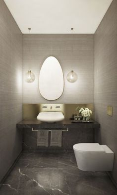 Contemporary powder room in a luxury Manhattan condo design by Groves & Co. | Rendering by The Seventh Art