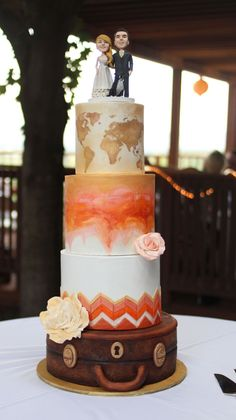 Travel Theme Wedding Cake Travel Theme Wedding Cake 4 tier wedding cake. I traveled this cake 3 1/2 hours in 108 degree weather. My most nerve racking delivery to...