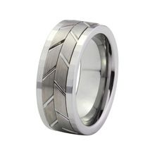 This 2.5 - 2.7mm thick tungsten men's ring has a classic style, but is sturdy enough to withstand hard work. It is 9mm wide and has faceted edges in the detail. www.cloverkitty.com #mensrings #shopcloverkitty #wedding #rings #mens #tungsten