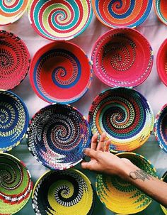 These colorful vessels give me ideas for clothesline wrapped bowls, dishes, baskets, etc. Great color transitions.