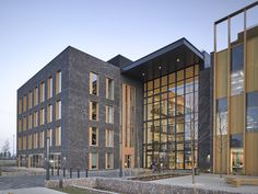 Image 8 of 18 from gallery of Discovery Drive Healthcare Village / NBBJ. Photograph by Nick Guttridge Healthcare Architecture, Modern Windows, Building Exterior, Natural Resources, Atrium, Design Firms, Countryside, Discovery, Health Care